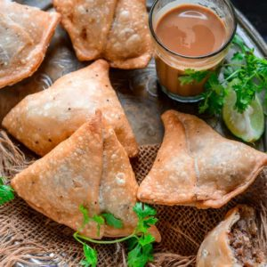 Samosa is a savory fried Indian snack which has a crispy outer crust and a spicy filling. Learn to make best Halwai style crispy Indian samosa at home using my easy recipe. Here is how to make Punjabi Samosa.