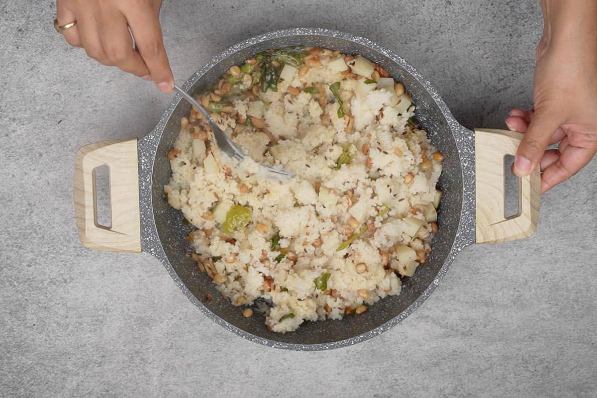 Ready bhagar fluffed with a fork.