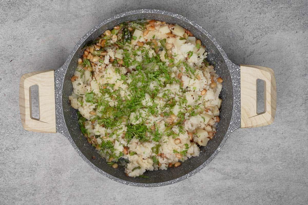 Ready bhagar garnished with cilantro.