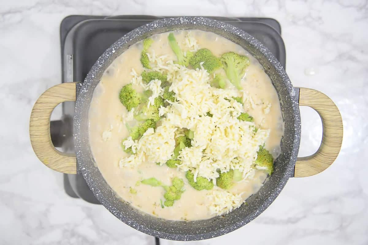 Broccoli and processed cheese added in the pan.