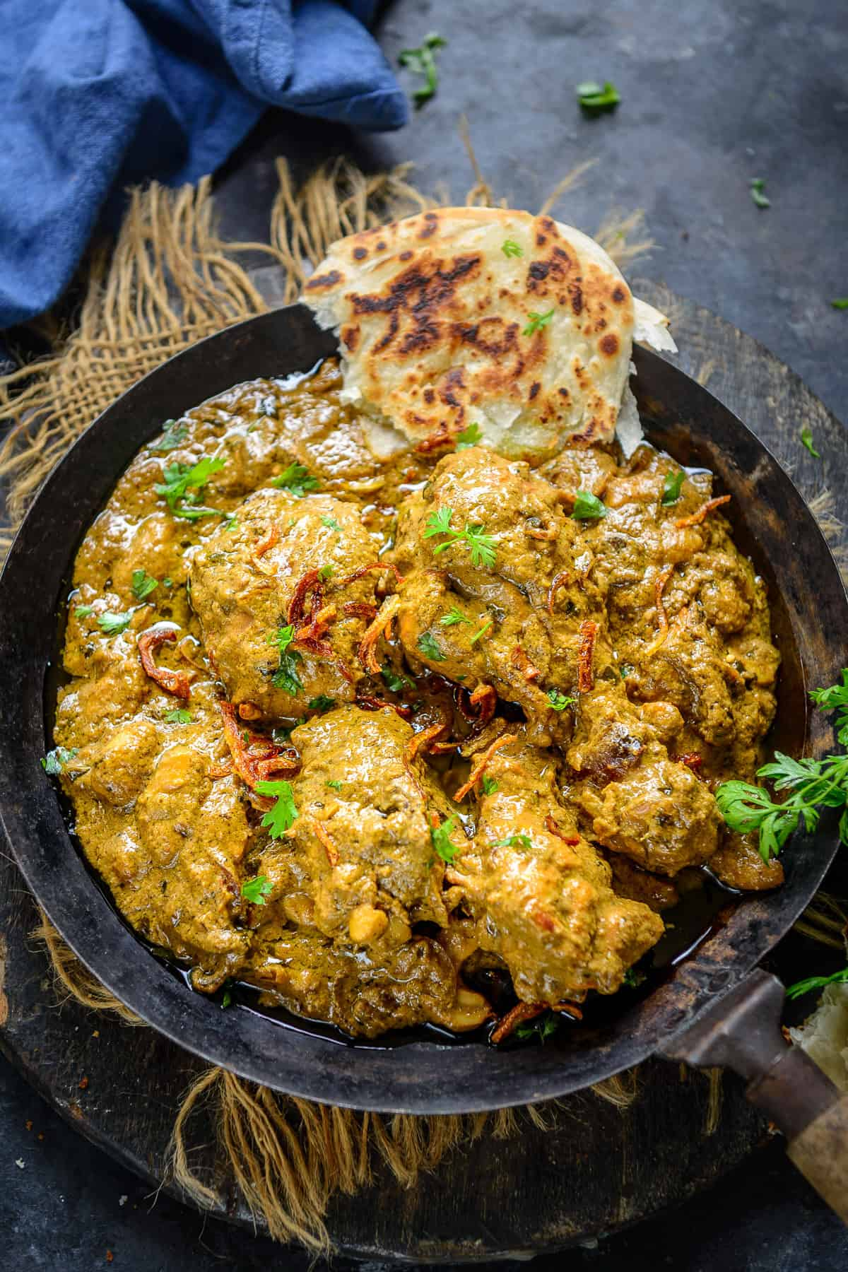 Coriander chicken curry served in a bowl.