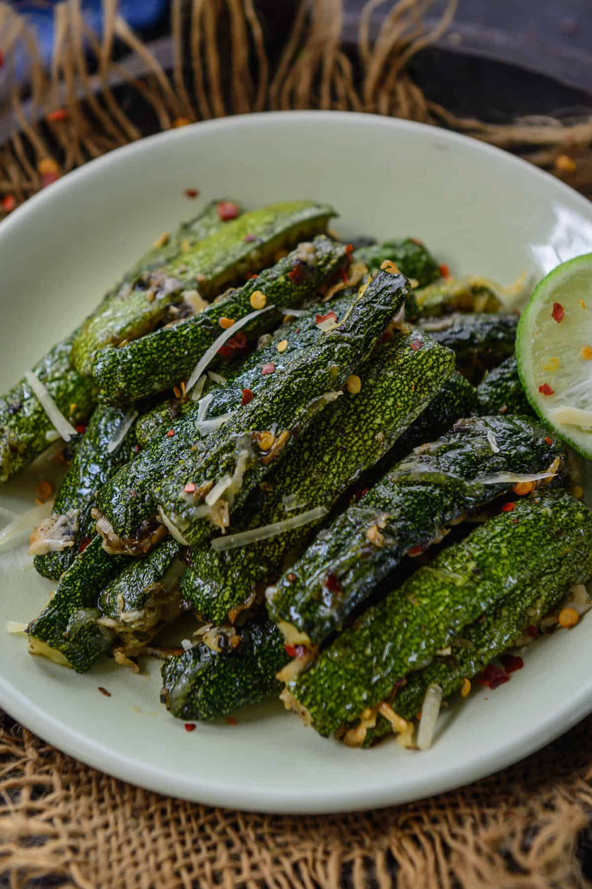Oven Roasted zucchini served on a plate.
