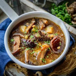 Russian Dried Mushroom Soup is a flavourful soup made using a mix of dried mushroom, barley and veggies. It is a hearty and fulling homestyle soup perfect for winters. Here is how to make Russian Dried Mushroom Soup.