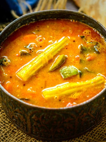 This tangy and Spicy Sambar is a South Indian staple dish that is served for all the meals including breakfast, lunch, and dinner. It is a stew of yellow lentils with vegetables and spices added to it. Here is my easy recipe to make it at home.