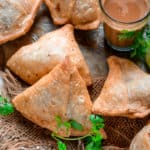 Want to make halwai style crispy samosa recipe at home? Look no further. Samosa is a savory fried Indian snack that has a crispy outer crust and a spicy filling. Make it at home using my easy recipe.