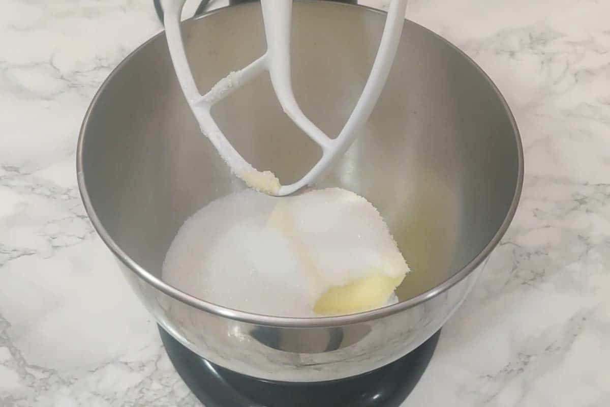 Butter and sugar added in the bowl of mixer.