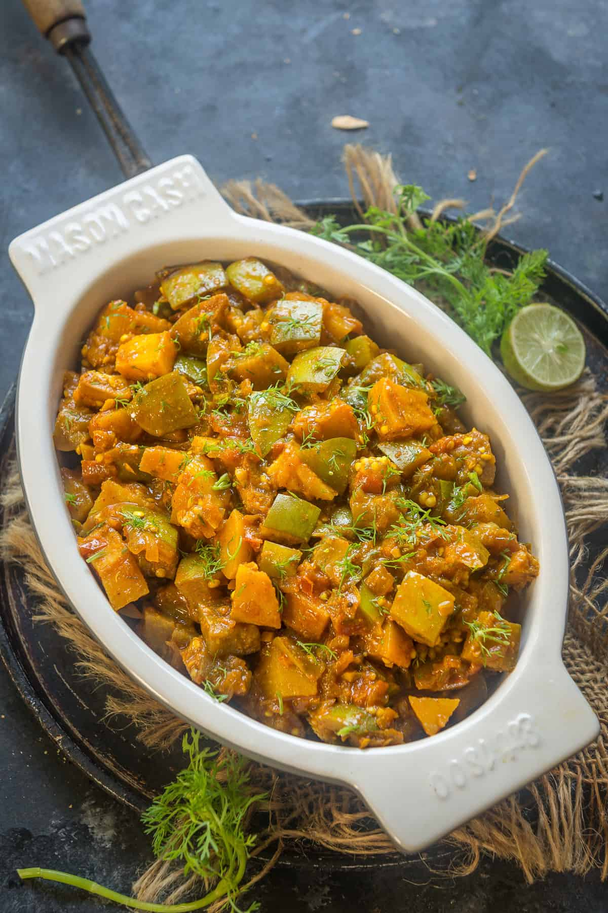 Aloo Baingan served in a bowl.