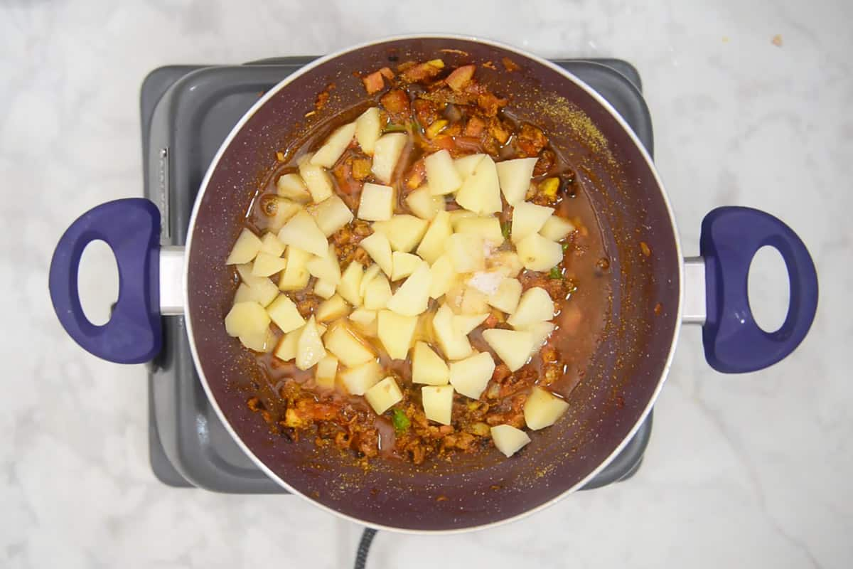 Potatoes, salt and water added to the pan.