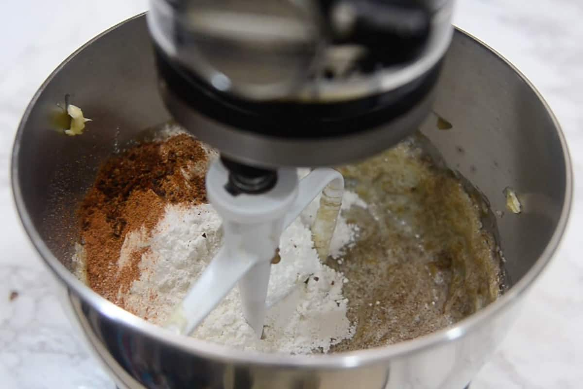 All-purpose flour, baking soda, ground cinnamon, ground nutmeg, and ground clove added in the mixer.