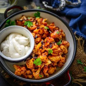 Buffalo Cauliflower is a delicious vegan appetiser which can be made in no time. It's crispy, spicy and healthy and makes for a great party snack. Here is how to make Buffalo Cauliflower Recipe.