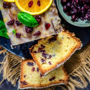 This easy homemade Cranberry Orange Bread is a super moist and crumbly quick bread that you can make this festive season. Follow my recipe and make a loaf for yourself.