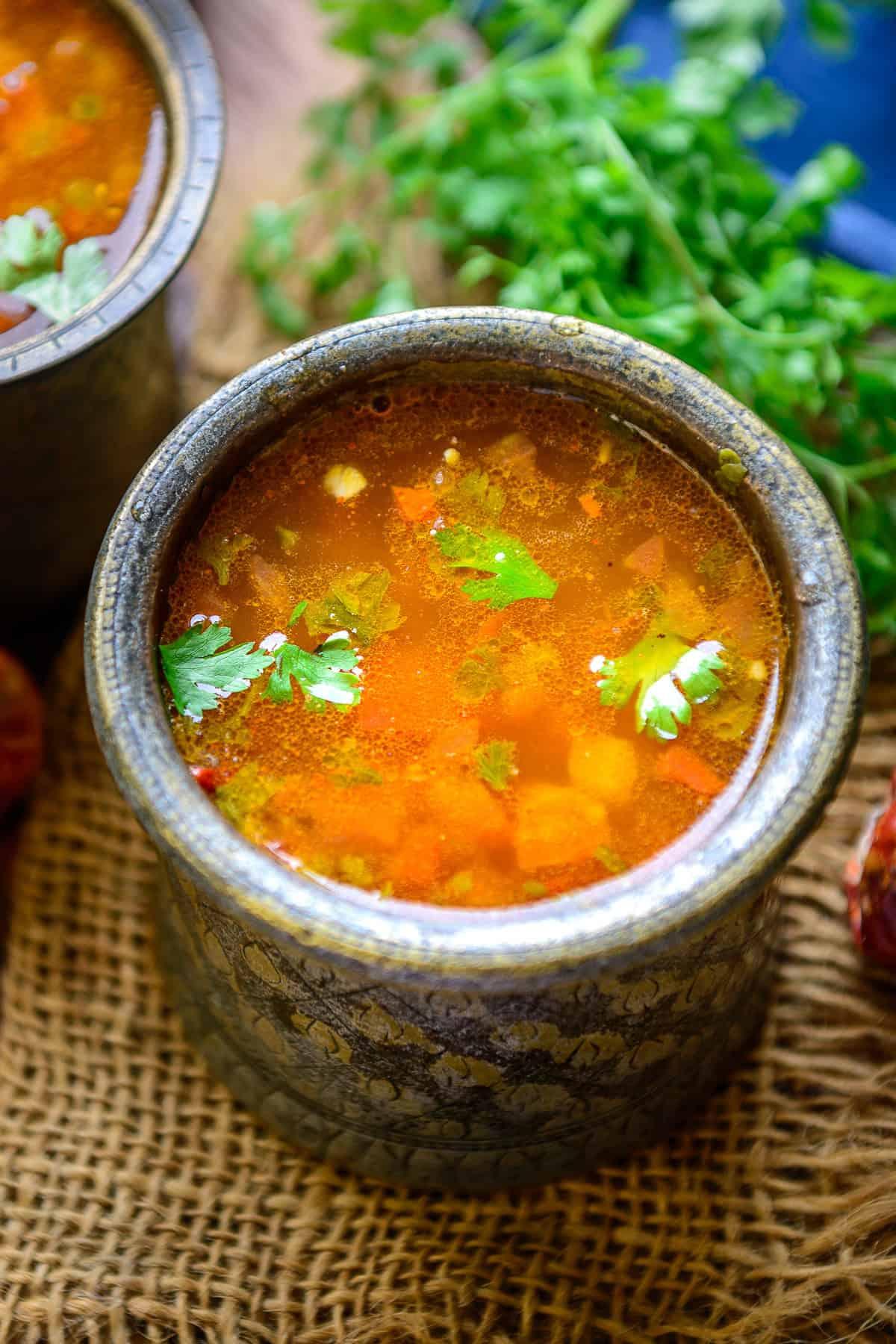 Tomato rasam served in a bowl.