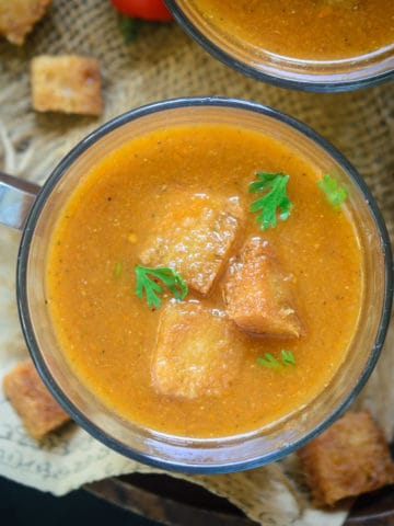 Tomato Shorba is an Indian style tomato soup which is thin in consistency, spicy from the use of spices and is very flavourful. Try this simple recipe to make this homemade soup. Here is how to make it.