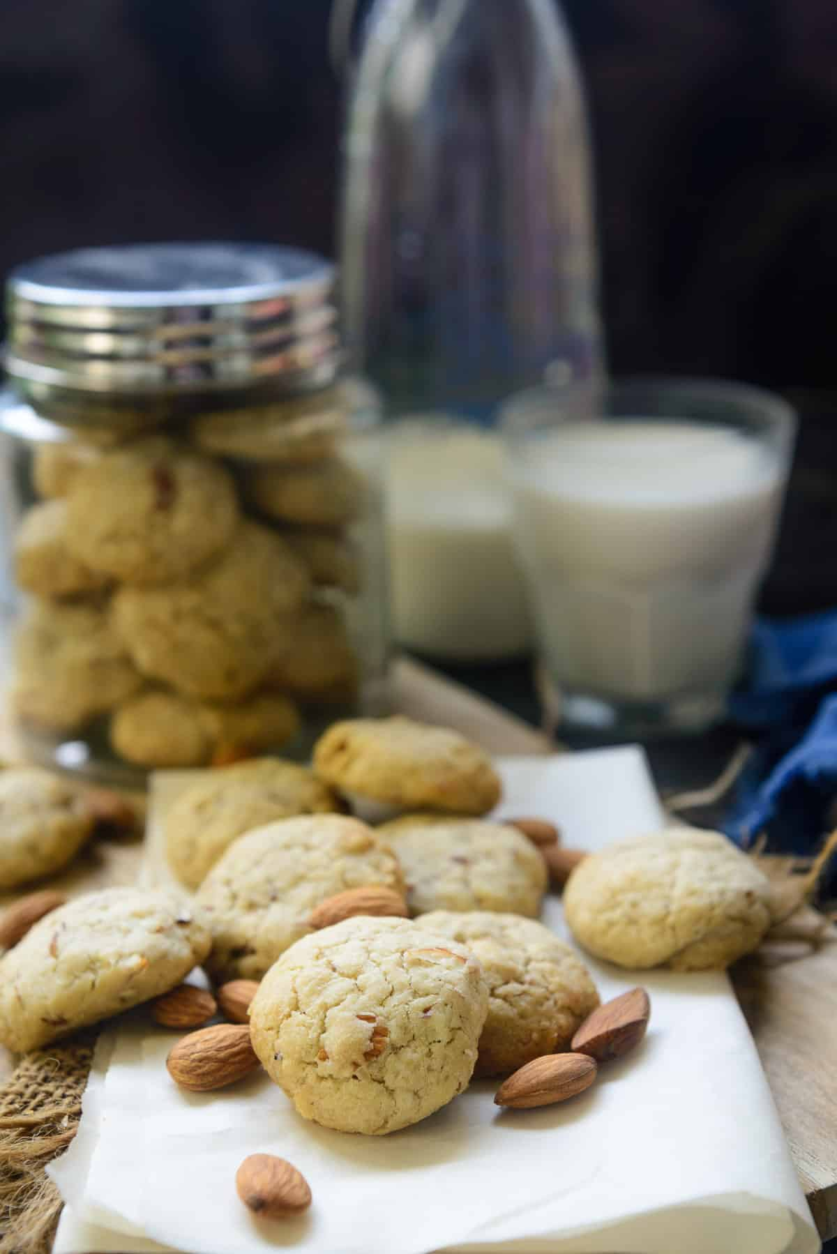 Almond Cookies scattered on a table.