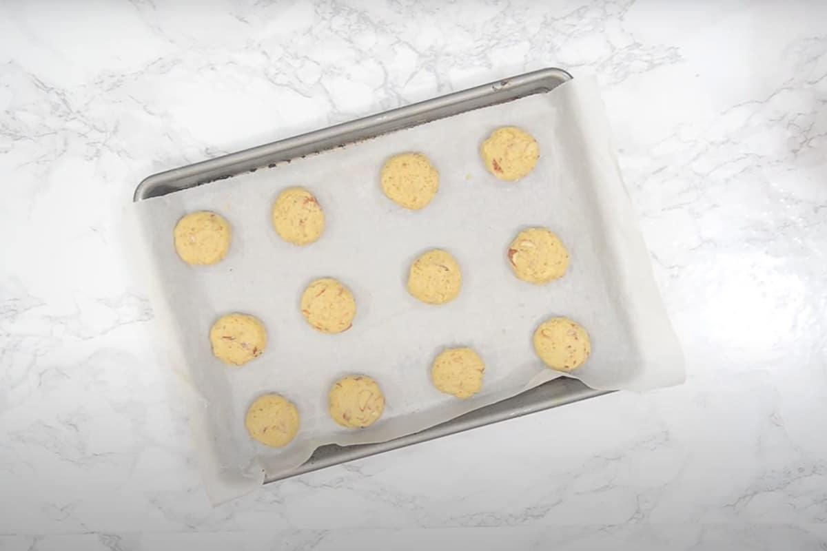Balls arranged on the baking sheet.