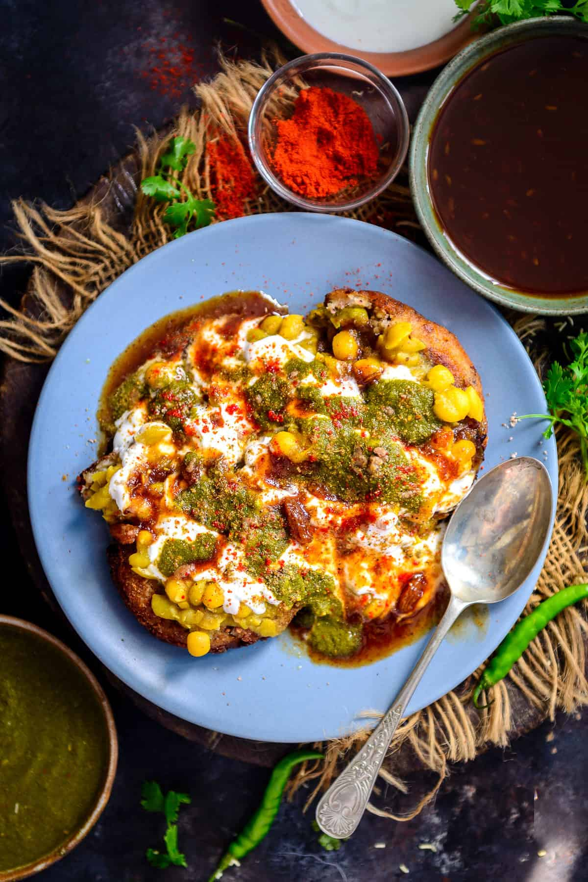 Aloo Tikki Chaat served on a plate.
