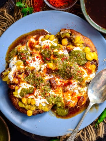 This tangy and spicy Aloo Tikki Chaat is one of the fav chaat dishes, where crispy Aloo Tikkis are topped with a Chickpea Curry and Chutneys. It is a popular street food in India and is loved by many.