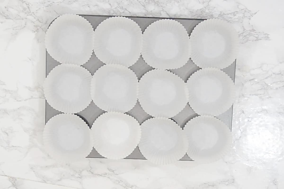 Muffin tray lined with liners.