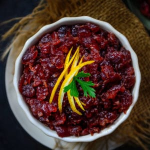 Cranberry Orange Chutney makes for a great accompaniment for Thanksgiving or Christmas Dinner. This homemade spicy chutney laced with Bourbon is a delight to eat. Here is how to make it.