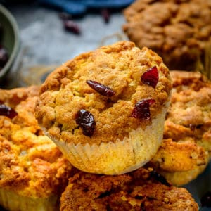 These Cranberry Muffins are bakery style fluffy and moist muffins and are very easy to make at home from scratch. With a refreshing flavor from orange zest and juice, these are a great breakfast or dessert option.