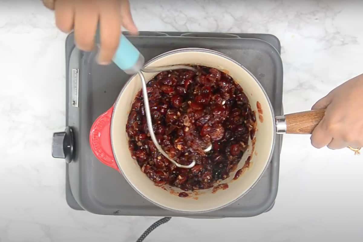 Chutney mashed with a potato masher.
