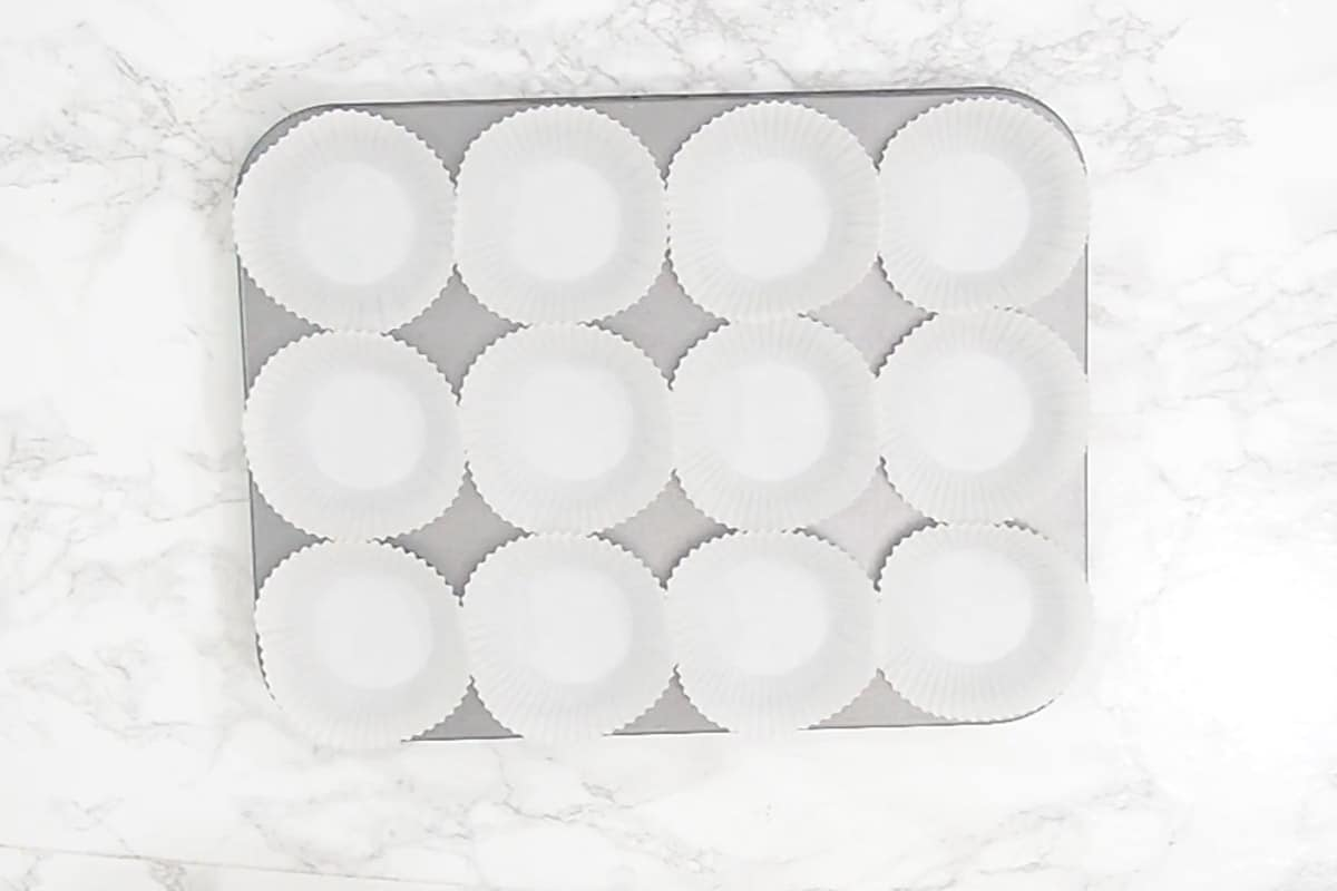 Tray lined with muffin liners.