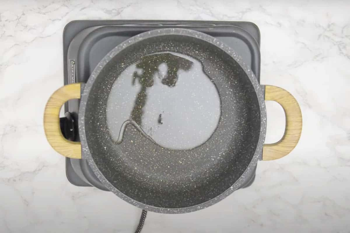 Vegetable oil heating in a pan.