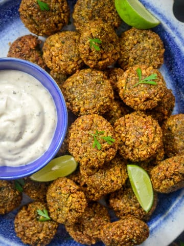Falafel is a very popular Middle Eastern street food made using chickpeas as it's base ingredient. It is crispy from outside and soft and moist from inside. Here is how to make this recipe at home.