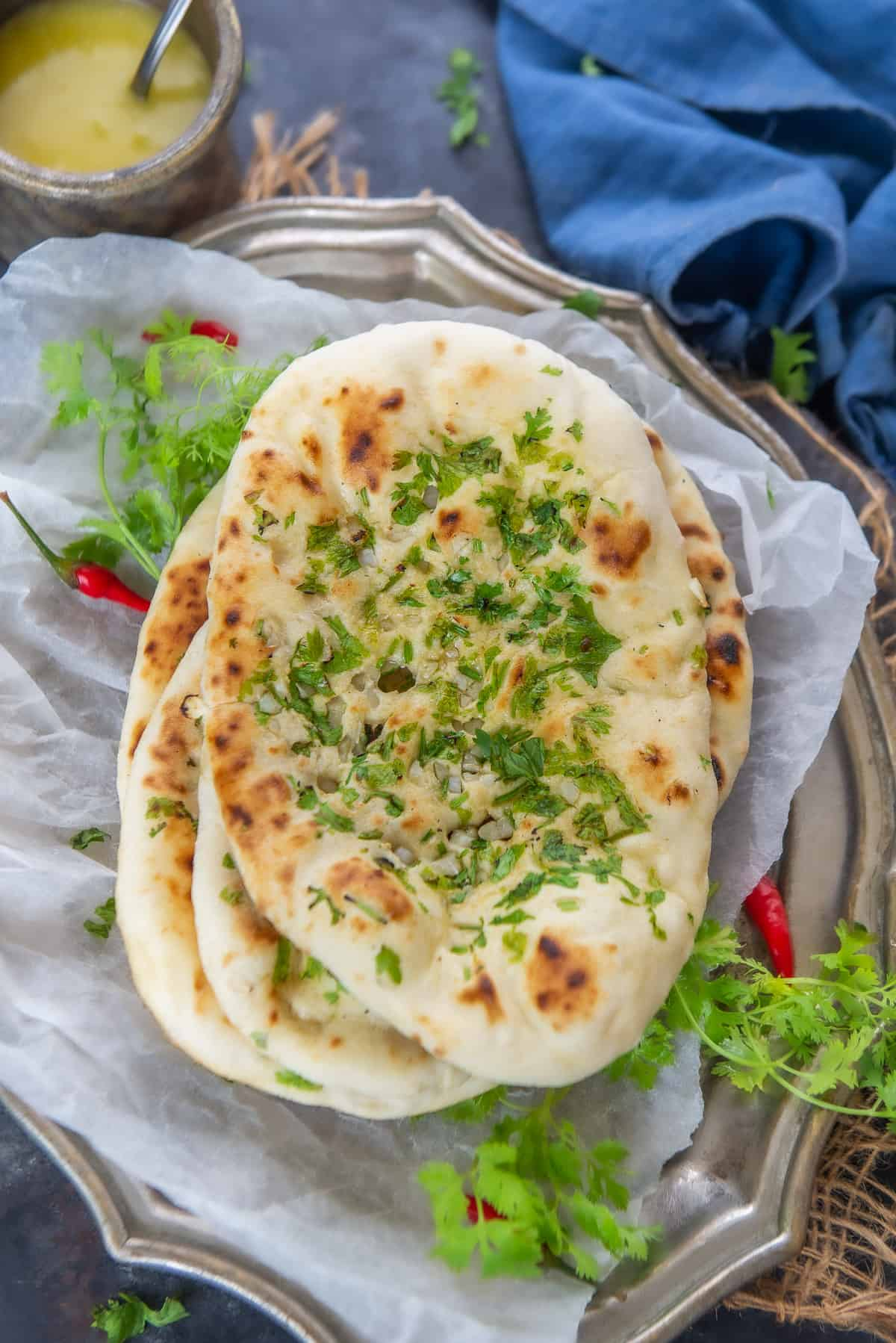 Garlic Naan served on a plate.