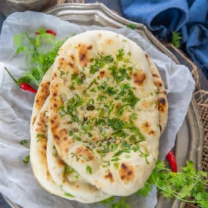 This buttery Garlic Naan is a delicious Indian bread which is made using all-purpose flour. Traditionally it is made in Tandoor, but now with this recipe, you can make it at home on a stovetop or in an oven.