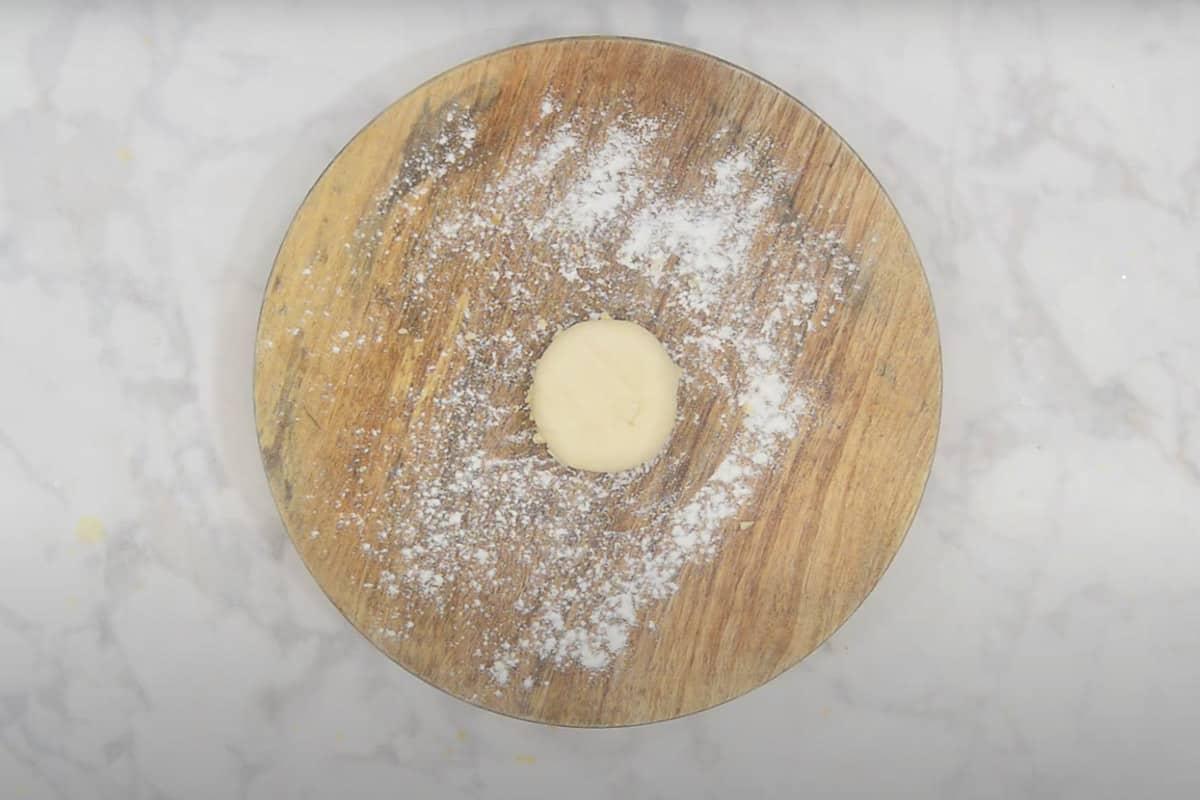 Dough ball kept over garlic.