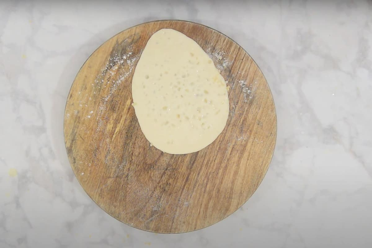 Water applied on one surface of the naan.