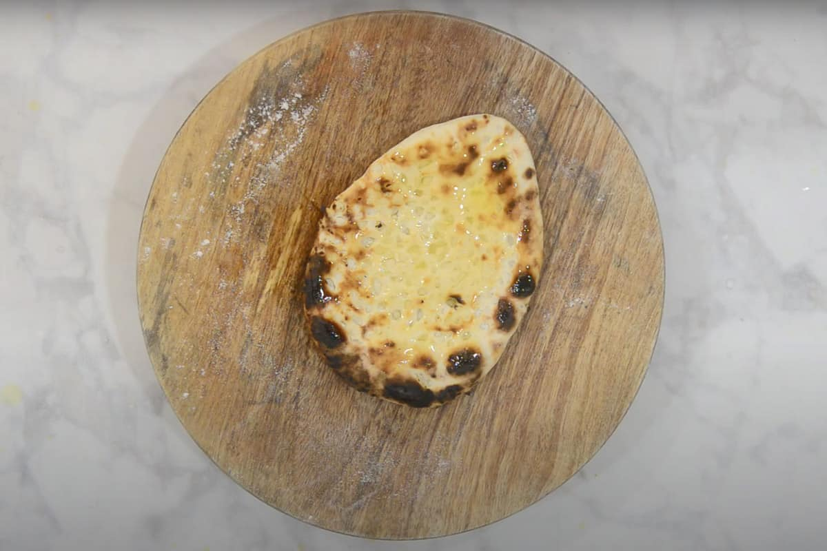 Ready garlic naan slathered with butter.