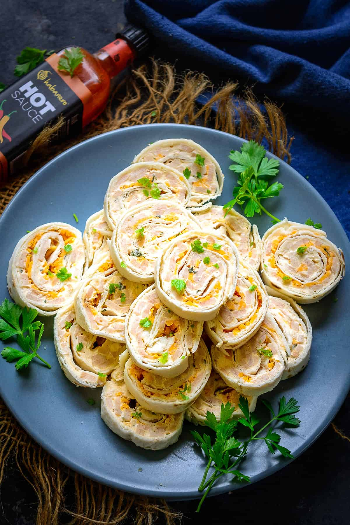 Ham and Cheese Pinwheels served on a plate.