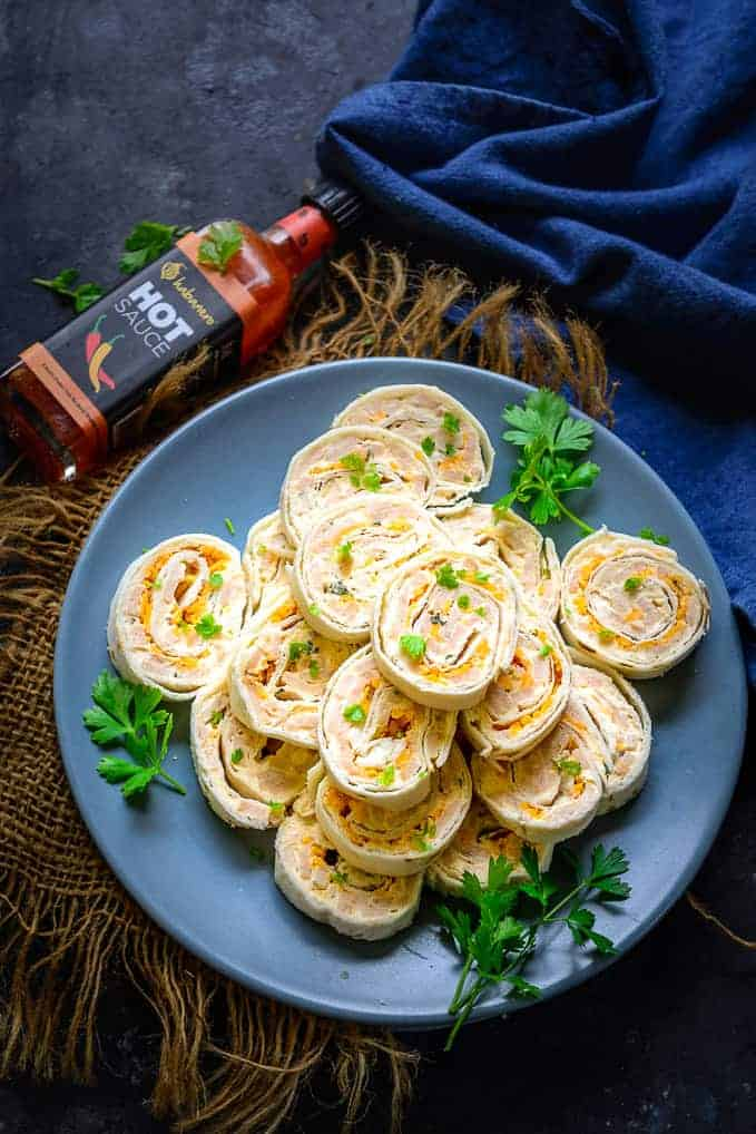 Cold Ham and Cheese Pinwheels served on a plate.