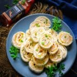 Ham and Cheese Pinwheels are an easy to make appetizer. This cold party appetizer is made using tortilla wraps, cream cheese and hot sauce. Here is how to make Ham and Cheese Pinwheels Recipe.