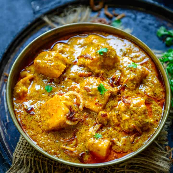 Paneer Korma is a Mughlai style Paneer dish where paneer cubes are cooked in a rich onion based gravy. This Indian curry is rich and creamy and goes well with breads. Here is how to make Paneer Shahi Korma recipe.