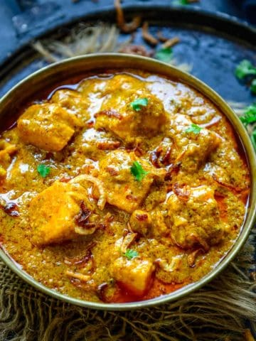Paneer Korma is a Mughlai Style Paneer dish where paneer cubes are cooked in a rich onion based gravy. This Indian curry is rich and creamy and goes well with Indian bread. Here is how to make Paneer Shahi Korma recipe.