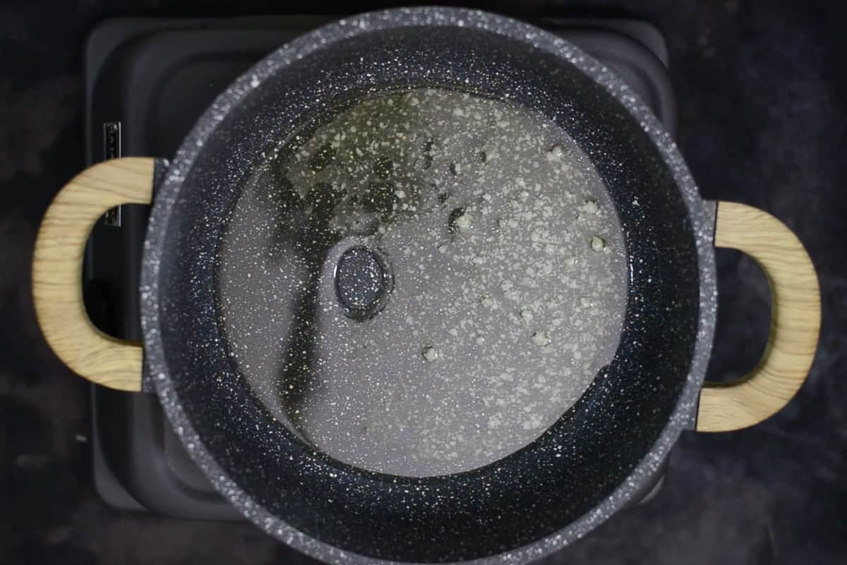 Oil and ghee heating in a pan.