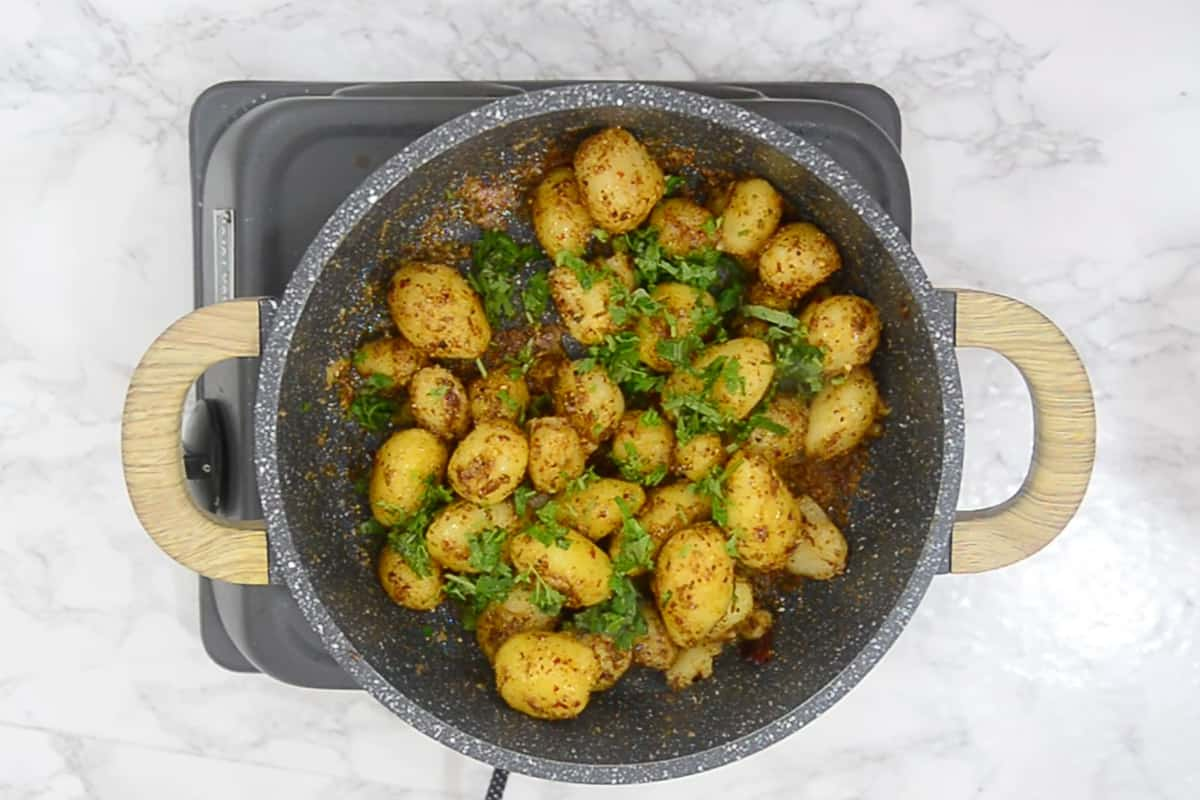 Ready baby potato roast garnished with fresh coriander.