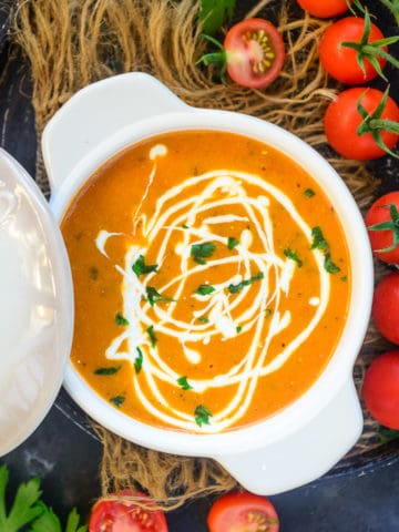 Tomato Bisque is easy to make creamy soup made using roasted tomatoes, fresh cream, and herbs. My recipe makes the best homemade version of this soup. Here is how to make it.