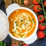 Tomato Bisque is an easy to make creamy soup made using roasted tomatoes, fresh cream and herbs. My recipe makes the best homemade version of this soup. Here is how to make Tomato Bisque Recipe.