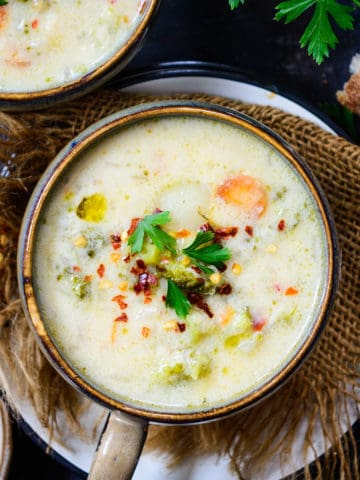Cheesy Vegetable Chowder is a filling, one-pot, gluten-free dish that is thick, creamy and soupy. It is packed with nutrition and the goodness of veggies.