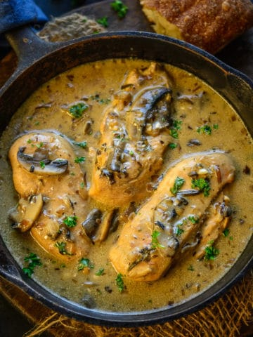 This Chicken with Mushroom Sauce is a delicious Italian recipe with crispy tender chicken cooked in a white wine infused mushroom sauce.
