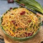 Chilli Garlic Noodles is a simple yet flavourful recipe where noodles are stir fried along with dry red chillies, garlic and lots of vegetables. Try it and it will surely satisfy your taste buds. Here is how to make Chilli Garlic Noodles Recipe.