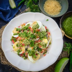 Egg Chaat is an easy to make snack or appetizer which is healthy as well. Boiled egg slices are topped with chutney and spices which gives a burst of flavor. Here is how to make it.