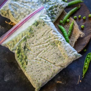 Freezing Fresh Peas when they are in season is a great idea to get a regular supply of great quality peas throughout the year. It's very economical too. Here is how to preserve peas at home.