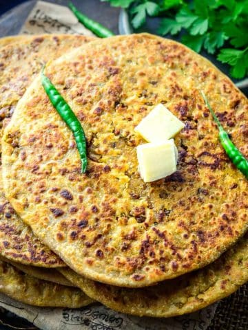 Keema Paratha is an Indian flatbread where the spicy and flavourful minced mutton mixture is stuffed into a whole wheat flour dough and then rolled to make a delicious paratha. Here is how to make it.
