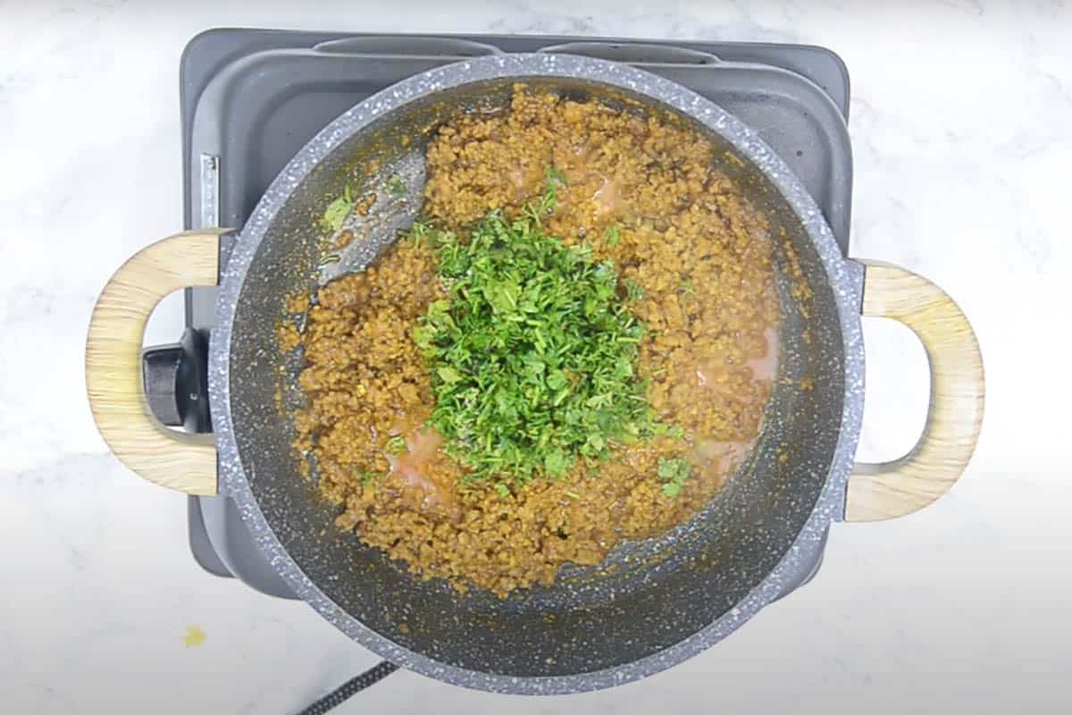 Lemon juice and coriander added in the cooked mutton mince.