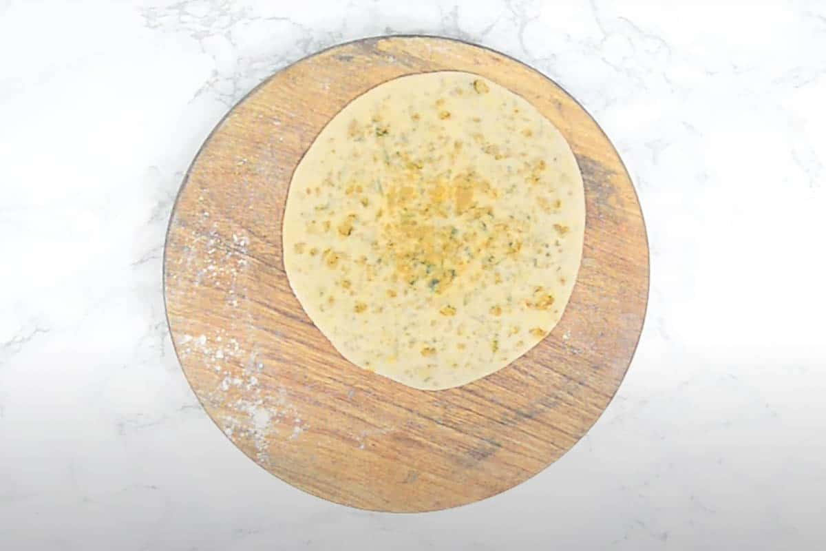 Rolled to make a 6 inch paratha.
